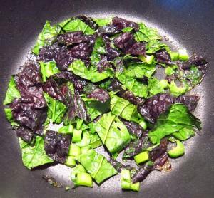 Saute chopped mustard greens