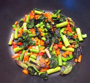 add cut asparagus to pan