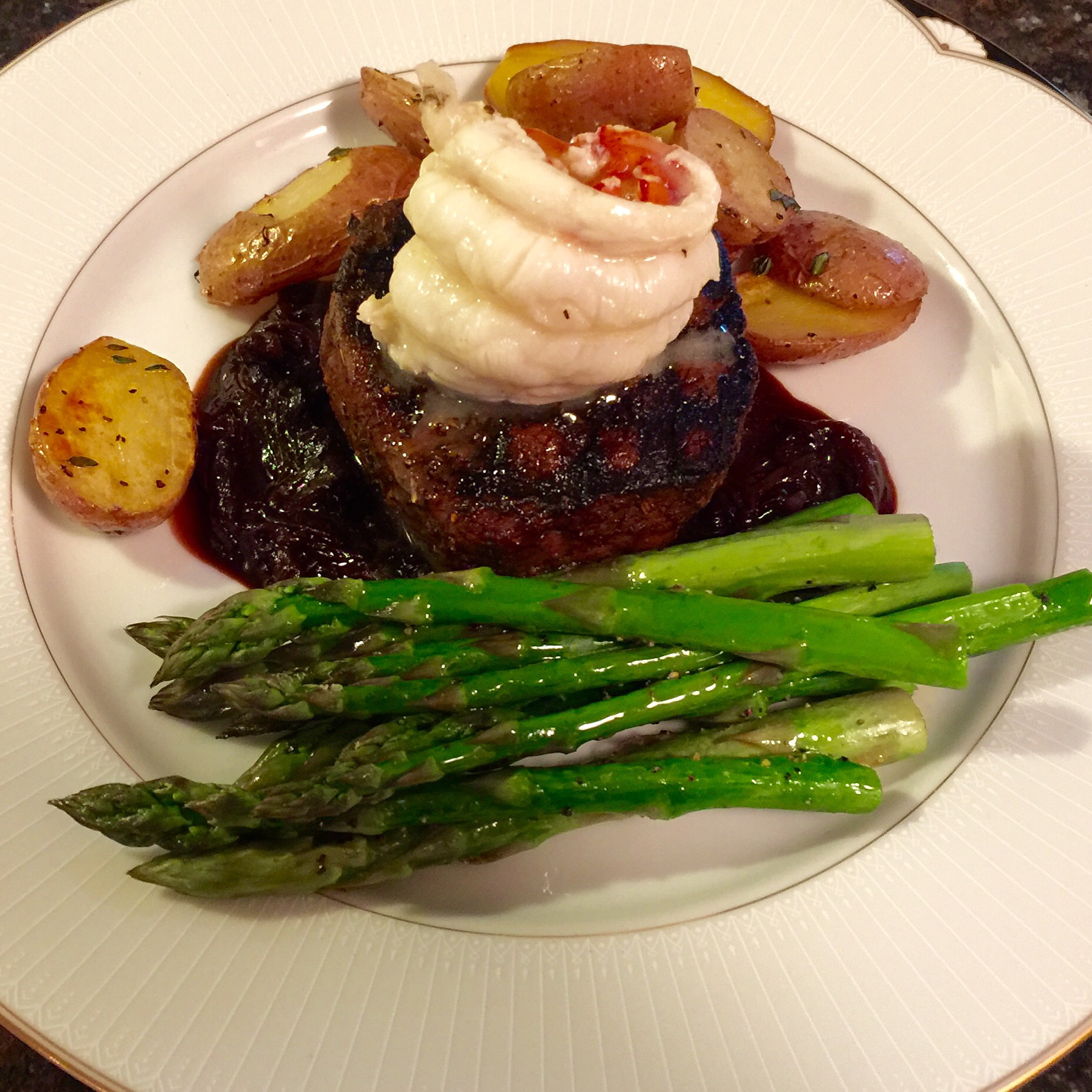 Grilled Tenderloin with Lobster Tail, Roasted New Potatoes and Asparagus